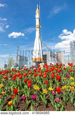 Samara, Russia - May 4, 2021: Flowers Tulips On The Background Of The Space Rocket Soyuz. Selective