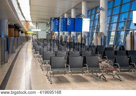 Modern Airport Terminal Waiting Room. Empty Airport Terminal Waiting Area. Empty Seat In The Airport