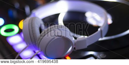 Music Console And Headphones For Dj. Dj Console For Experiments Music
