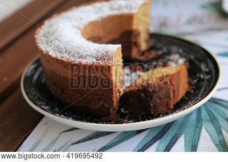 Marble Cake Cup Of Coffee Powder Sugar, Closeup