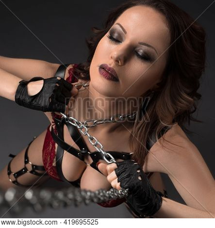 Woman In Lingerie With Metal Chain Around Neck