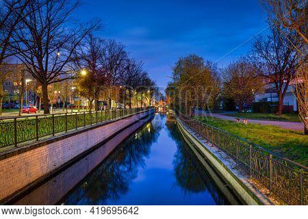 Beautiful scenery of the Radunia canal in Pruszcz Gdanski at dusk, Poland.