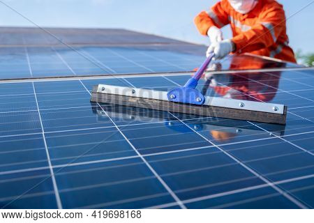 Close Up Mop Of Loperation Team Use A Mop Working On Cleaning Solar Plant For Good Performance In Se