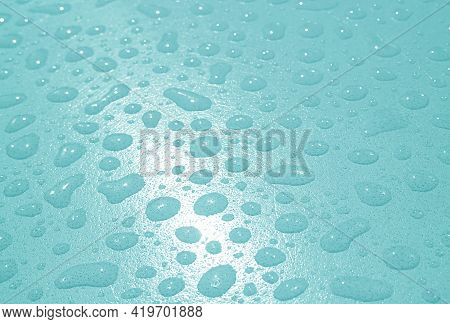 Pop Art Style Pastel Arctic Blue Colored Water Droplets On The Tabletop After The Rain