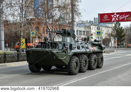 Armored Personnel Carrier. Military Equipment Drives Through Empty Streets Of City. Preparations For