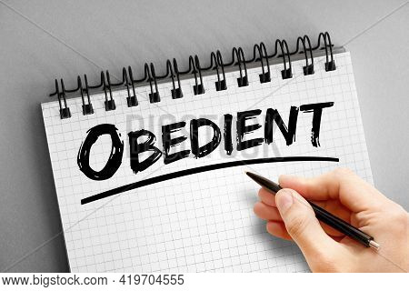 Obedient - Text On Notepad, Concept Background