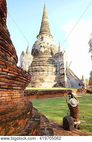 Visitor Taking Photos Of The Famous Historic Pagoda Of Wat Phra Si Sanphet In Ayutthaya Historical P