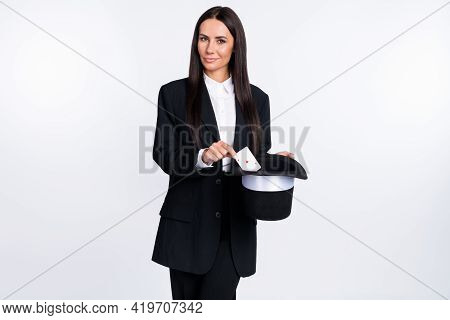 Photo Of Happy Smiling Lovely Woman Magician Put Card In Cylinder Trick Magic Illusion Isolated On W