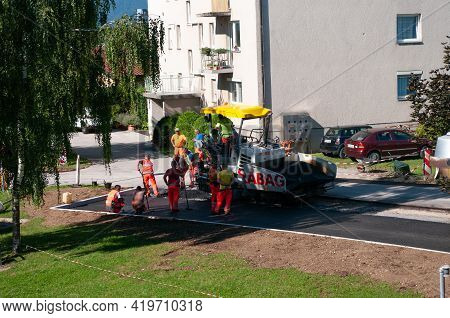Polzela, Slovenia - July 13, 2020: Workers On The Street Of The Village Is Laying A New Asphalt Pave