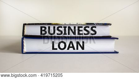 Time To Business Loan. Concept Words 'business Loan' On Books On A Beautiful White Background. Busin