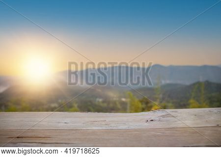 Empty Wood Table For Present Product With Soft Blur Natural Forest With Mountain Background