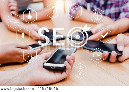 Seo Search Engine Optimization Concept With Phone Community Team. Group Of Teamwork Working To High