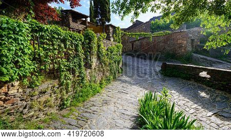 Old Town Alleys With Ivy-covered Walls And Morning Light. Patones De Arriba Madrid. Spain.