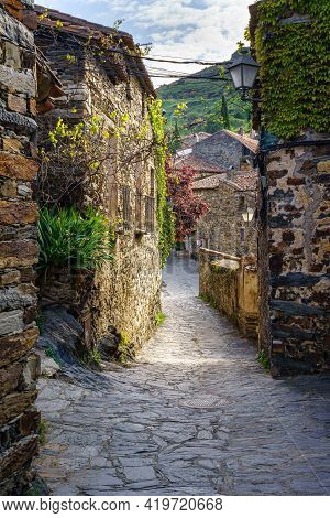 Beautiful Alley Of Stone Houses With Morning Light Entering Between The Buildings. Patones De Arriba