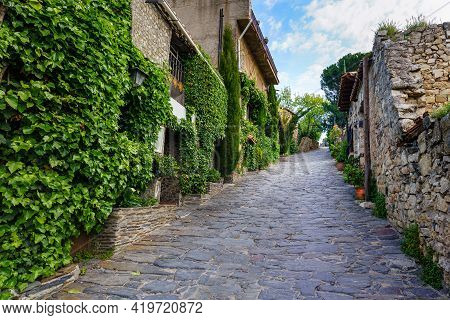 Old Medieval Village Houses With Steep Narrow Alley And Ivy Facades. Patones De Arriba Madrid. Spain