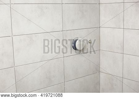 Bathroom Gray Tiles With Neat Rectangular Patterns And Built-in Shower. Bathroom Tiles Texture. Repa