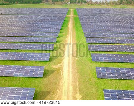 Drone View Of A Solar Power Plant On A Sunny Day. Solar Farm System With A Drone. A Source Of Ecolog