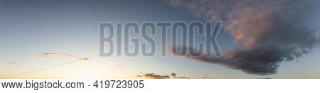 Panoramic View Of Cloudscape With Puffy Sky And Clear Sunny Sunlight During A Colorful Sunset Or Sun