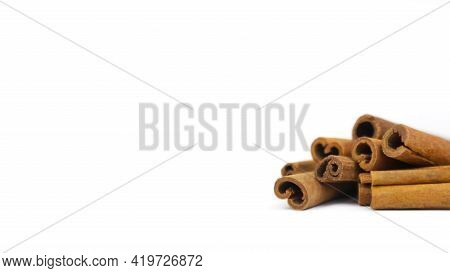 Cinnamon Sticks Isolated On White Background With Copy Space. Closeup, Cinnamon Sticks A Lot.