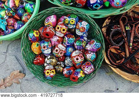 Mexican Handcrafts, Isla Mujeres. Decorative Human Skulls  Made Usually By Hand From Clay That Are U