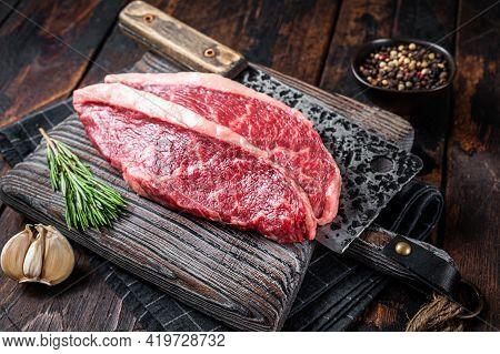 Raw Top Sirloin Cap Beef Meat Steaks On Butcher Board With Meat Cleaver. Dark Woden Background. Top