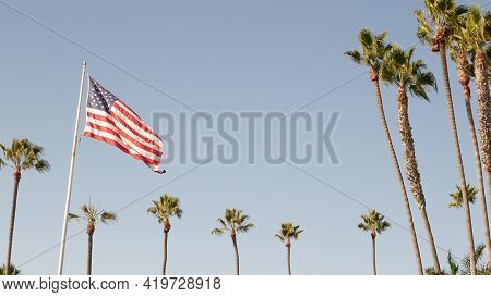 Palms And American Flag, Los Angeles, California Usa. Summertime Aesthetic Of Santa Monica Venice Be