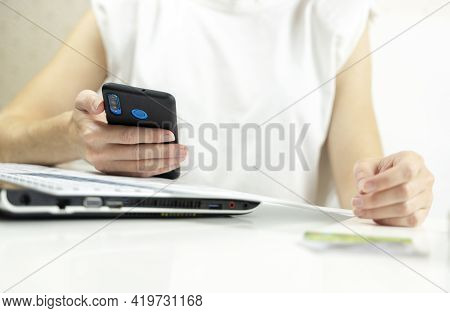 Smartphone And Receipts In The Girl's Hand, Online Payment Concept In