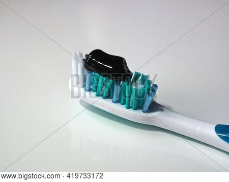 Toothbrush With Black Toothpaste. Oral And Dental Hygiene. Toothpaste With Natural Ingredients