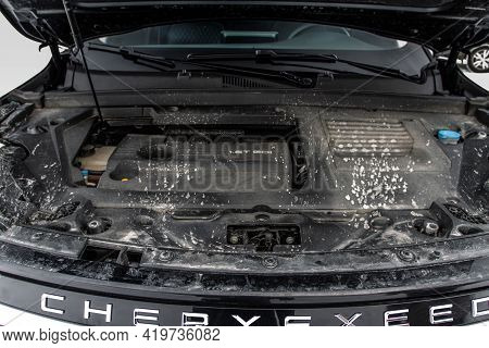 Moscow, Russia - February 23, 2021 Cheryexeed Txl Suv Close Up Engine View With Opened Car Bonnet.