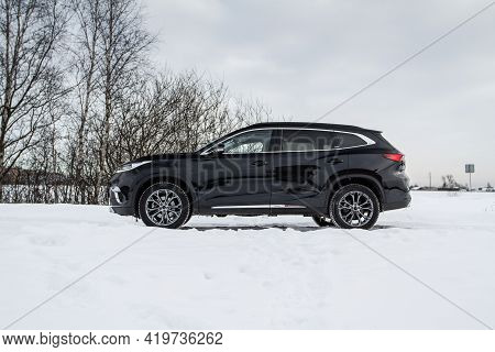Moscow, Russia - February 23, 2021 Cheryexeed Txl Suv Car Front Side Close Up View. Black Awd Suv On