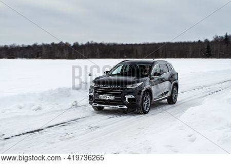 Moscow, Russia - February 23, 2021 Cheryexeed Txl Suv Car In Motion Front Side View. Black Suv On Na