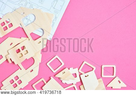 Details And Instructions, Constructor Of Prefabricated Wooden Orphanage On Pink Background
