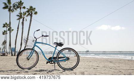 Blue Bicycle, Cruiser Bike By Sandy Ocean Beach, Pacific Coast, Oceanside Pier California Usa. Summe