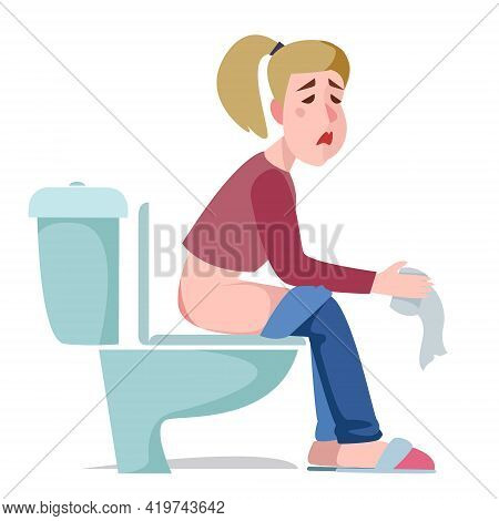 The Girl Is Sitting On The Toilet With A Sad Facial Expression. Diarrhea, Poisoning Or Hemorrhoids.