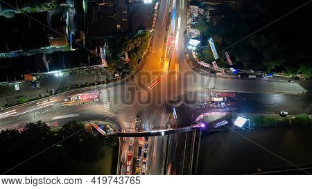 Traffic Jam On The Polluted Streets Of Bekasi At Night. The Traffic Congestion Is Limited In Few Are