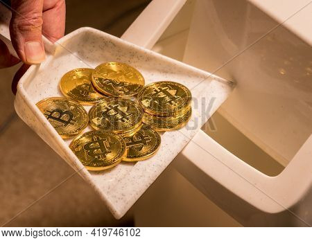 Brushing Bitcoins Into A Dustpan As Concept For The Collapse In Value Of Cyber Coins And Digital Cur