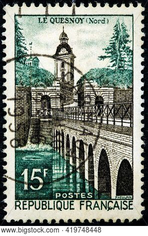 France - Circa 1957: A Stamp Printed In France Shows The Le Quesnoy Castle And Bridge Circa 1957