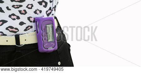 Diabetic Girl Applying An Insulin Pump - Childhood Diabetes Concept
