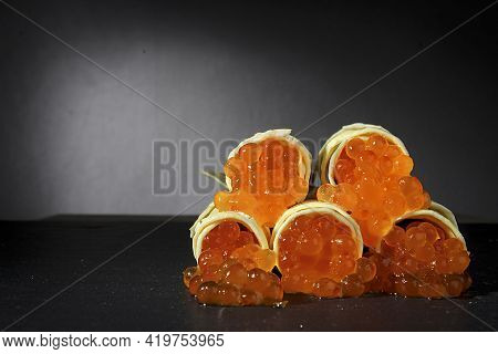 Pancakes With Red Caviar Close-up On A Gray Background