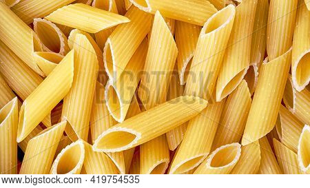 Italian Pasta Penne Close-up Top View, Food Background