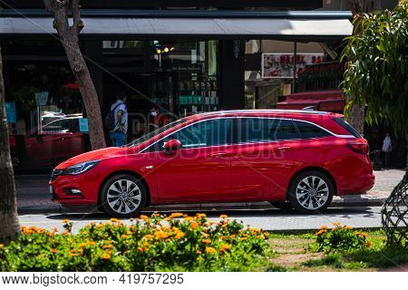 Alanya, Turkey - April 17 2021:  Red Opel Astra  Is Parked  On The Street On A Warm Summer Day Again