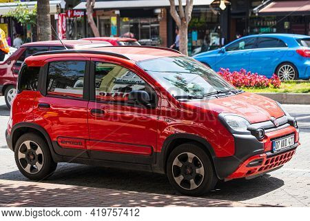 Alanya, Turkey - April 17 2021:    Red  Fiat Panda City Cross  Is Parked  On The Street On A Warm Su