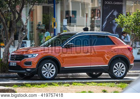 Alanya, Turkey - April 17 2021:   Orange Volkswagen T-roc   Is Parked  On The Street On A Warm Summe