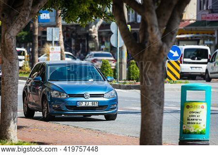 Alanya, Turkey - April 19 2021:  Blue Volkswagen  Golf     Is Parked  On The Street On A Warm Summer