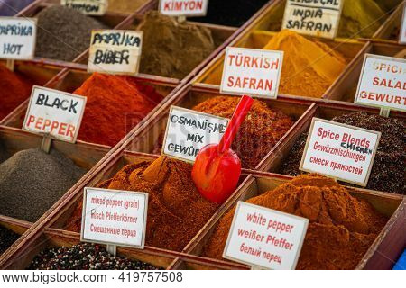 Close-up Of Beautiful Rows Of Fresh Spices: Turmeric, Cumin, Red And Black Pepper,parsley, Peppers,
