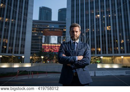 Portrait Of A Confident Mature Businessman Standing Outside Office. Smiling Business Man Ceo Standin
