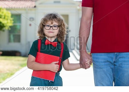 School Boy Going To School With Father. Teachers Day. Portrait Of Happy Nerd Pupil Holding Teachers