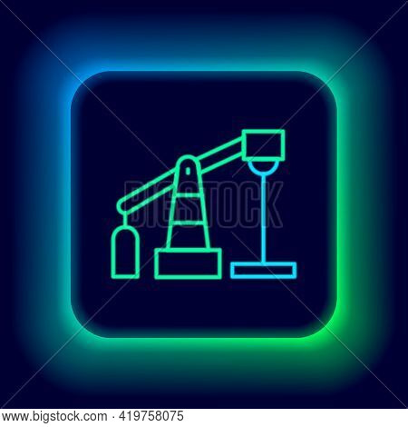 Glowing Neon Line Oil Pump Or Pump Jack Icon Isolated On Black Background. Oil Rig. Colorful Outline