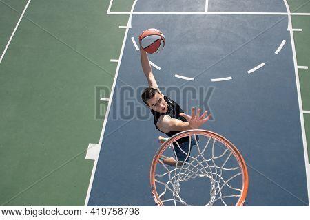 American Basketball Player Scoring A Slam Dunk.