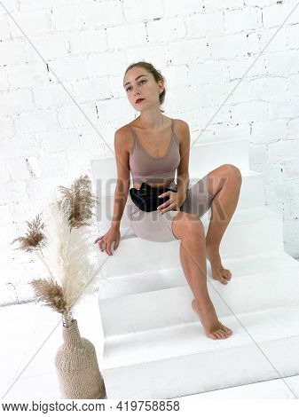 Beautiful Young Woman Holding Sling Or Hip Bag